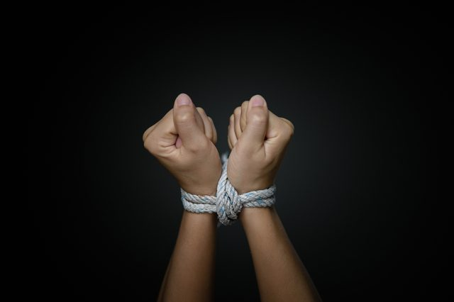 Woman hands were tied with a rope. Violence, Terrified, Human Rights Day concept.