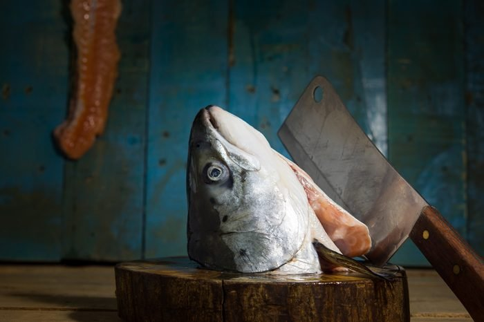 Still life salmon head on Chopping Wood and knife