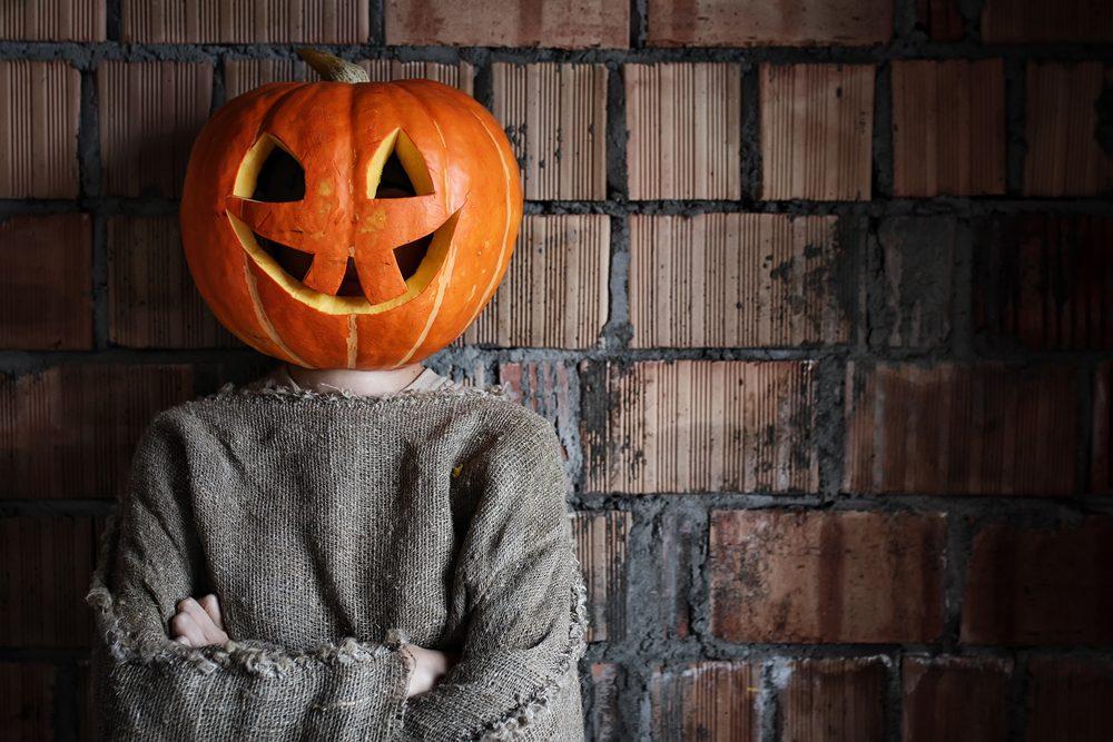 pumpkin head monster sign hand space halloween