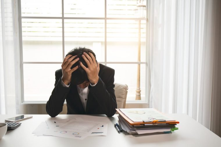 Menopausal men are suffering from headaches and migraines after working hard on accounting documents.