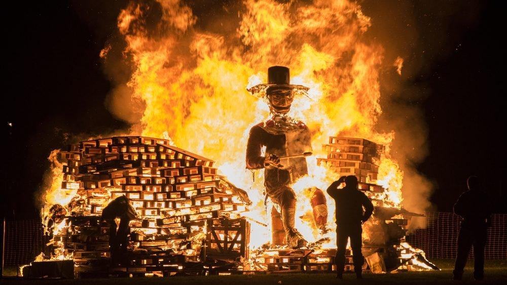 man standing in front of a guy fawkes bonfire during the 5th of november at lindifield mitoticoshutterstock not all countries celebrate halloween