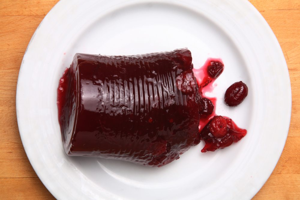 Canned cranberry sauce on white plate
