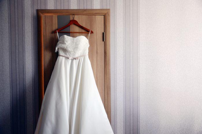 White long wedding dress on the hanger