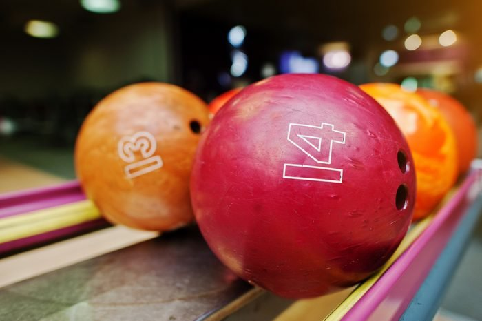 Two colored bowling balls of number 14 and 13