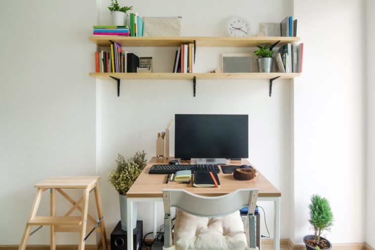 Home office working space. wooden shelf with white wall