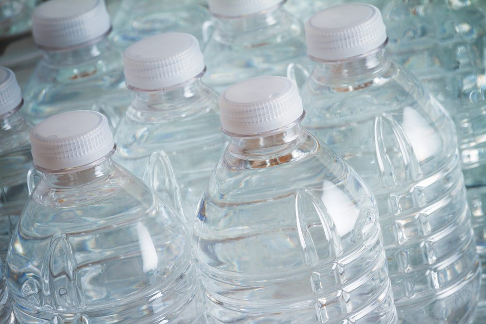 Transparent drinking water bottles with white caps