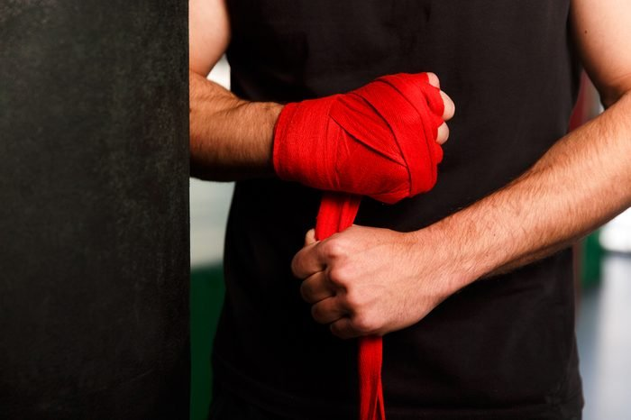 Hands athlete with wrist wraps