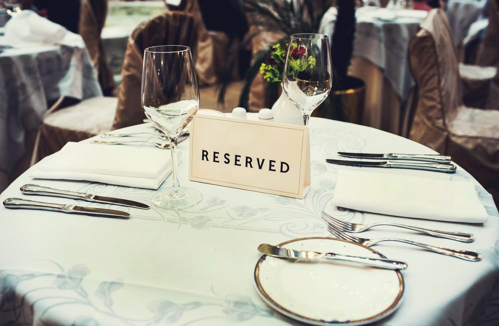 Reserved sign on the table in a fancy restaurant