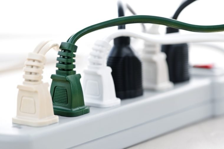 Many plugs plugged into electric power bar