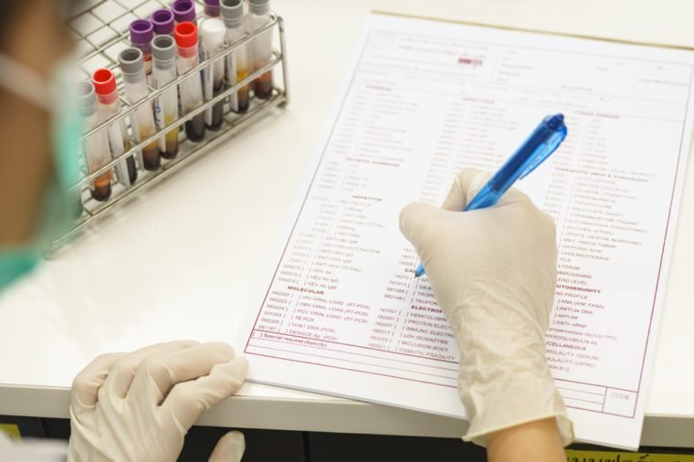 scientist record result of blood inspection in report form