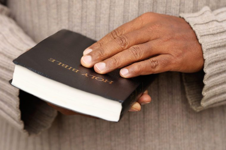 Man holding a Bible in his hands.