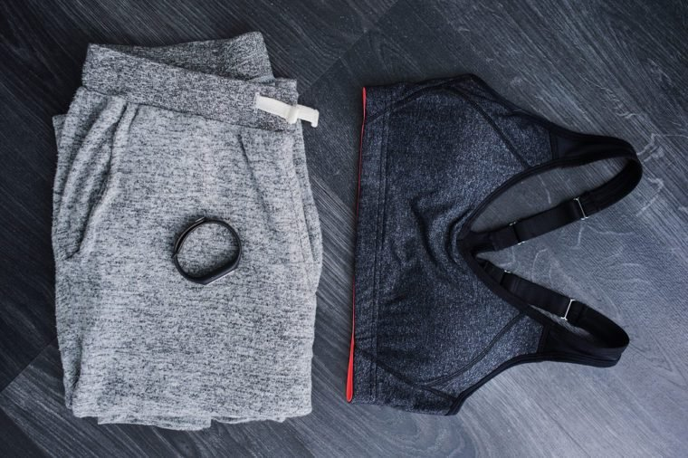 Gym outfit - workout clothing in gray colors. Matching clothes, sports bra.