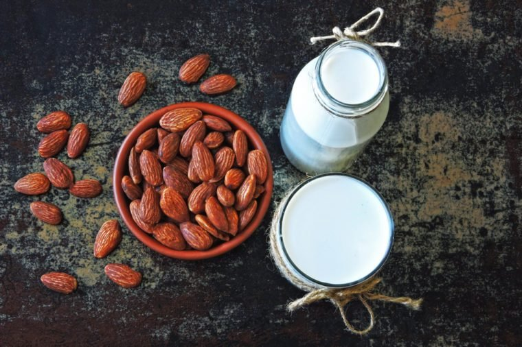 Almond milk and almonds. The concept of cooking almond milk. Vegan milk.