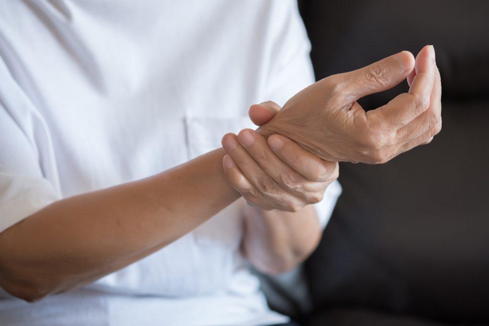 Elderly woman suffering from pain From Rheumatoid Arthritis