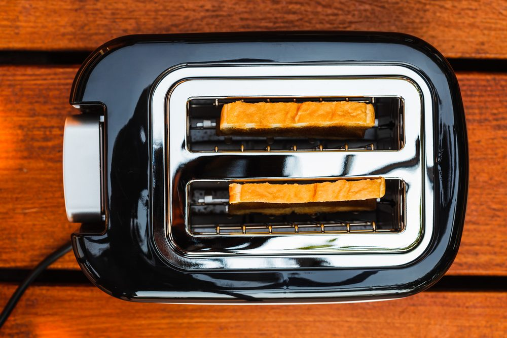 High angle picture of toaster with two sliced bread