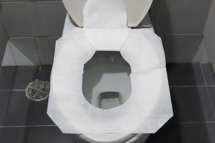 Toilet paper put on Open Toilet seat. Cover The Toilet Seat With Tissue Paper.