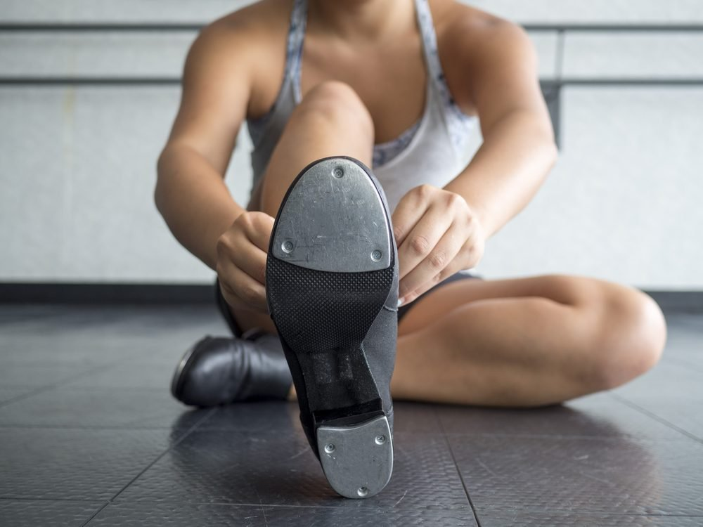 Dancer Putting on her Tap Shoes
