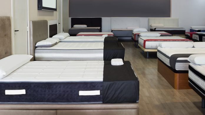Photo of new comfortable mattresses in the shop