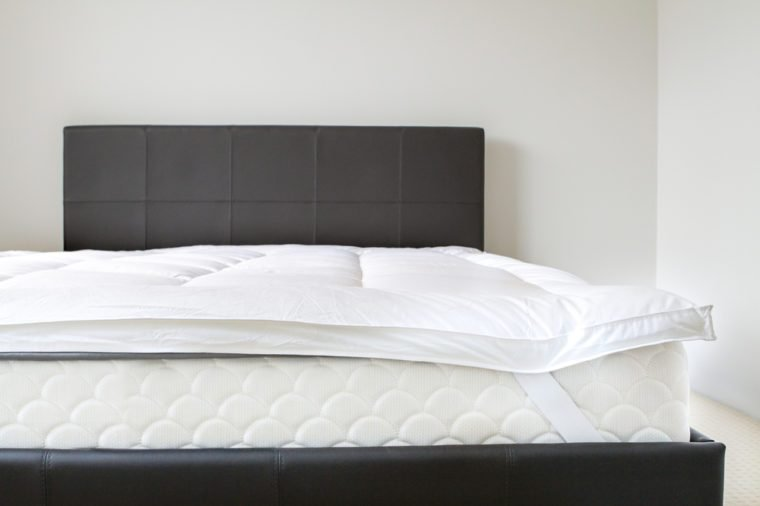 mattress bed topper in a modern bed room
