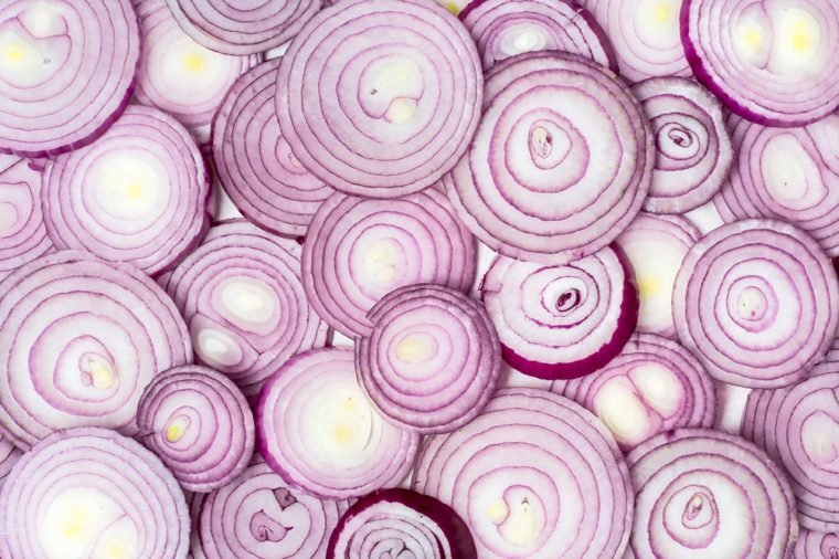 Background photo of sliced red onions.