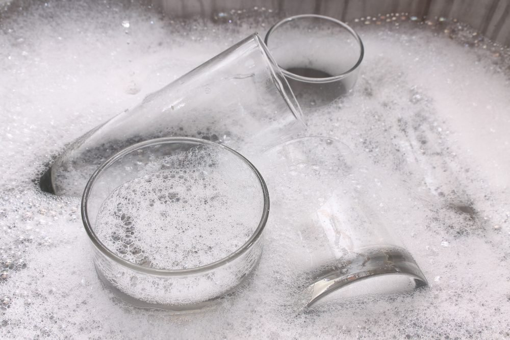 Washing dirty glasses with detergent and water