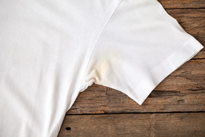 Shirts dirty caused by roll- on deodorant on wooden background