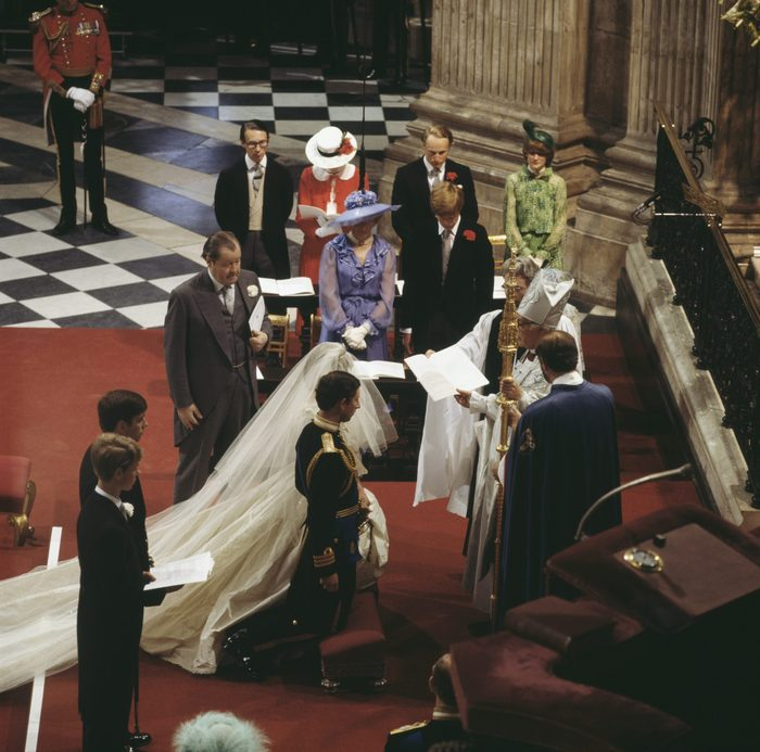 Prince Andrew and Prince Edward are behind their brother Charles, and John Spencer, 8th Earl Spencer, gives his daughter away. Behind them are Diana's mother, Frances Shand Kydd, her brother Charles, and her sisters Jane Fellowes and Sarah McCorquedale. Robert Runcie, the Archbishop of Canterbury, conducts the ceremony.