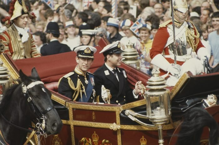 Prince Charles (left) and his brother Prince Andrew arrive in a carriage for Charles's wedding