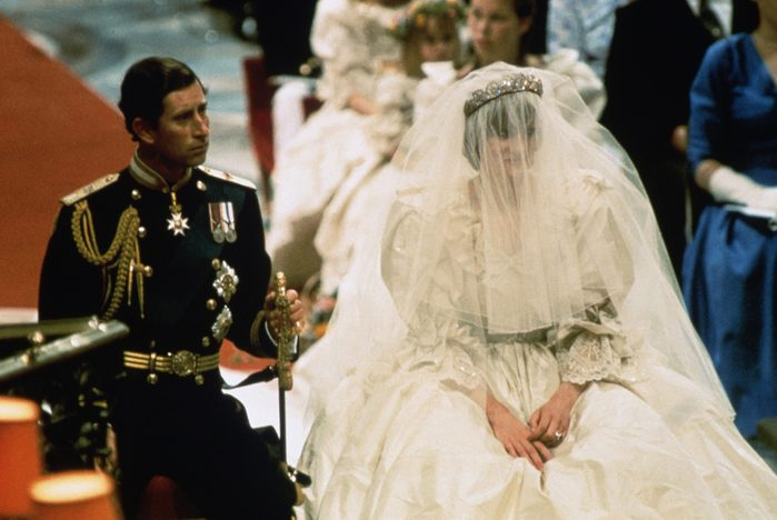 Photo of Prince Charles and Lady Diana Spencer, shown seated during their wedding ceremony