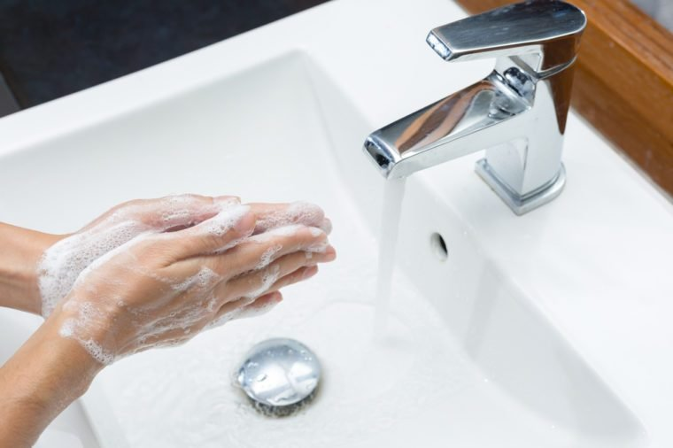Clean hands by washing hands with soap