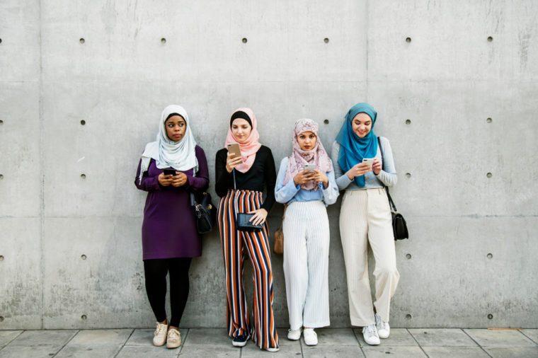 Islamic friends using smart phone