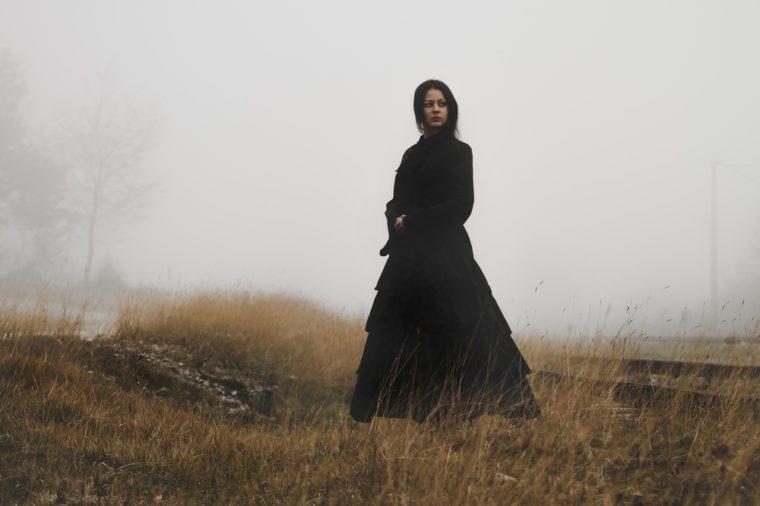 Classic horror scene of woman in black dress