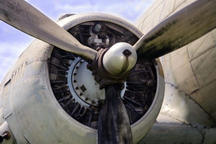 Propeller and engine of a vintage military airplane.