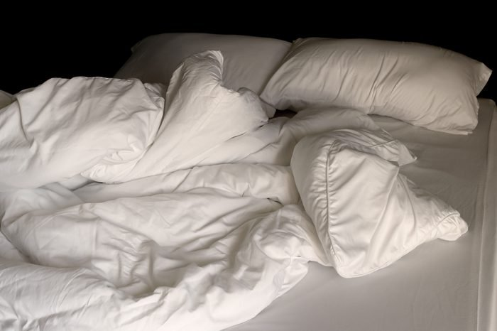 Messy bedding sheets and pillow