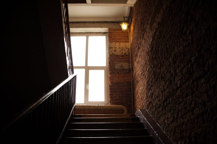 beautiful light in the interior, light bulbs illuminate the apartment. light from the window lights the staircase