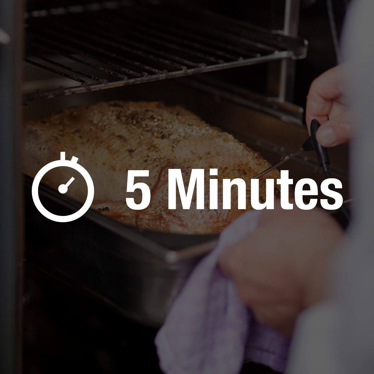 Closeup of chef's hands checking temperature of grilled turkey in commercial kitchen