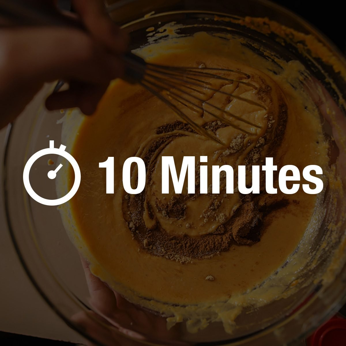 pumpkin pie recipe concept - woman whisking in cinnamon and spices for batter shot from pov view