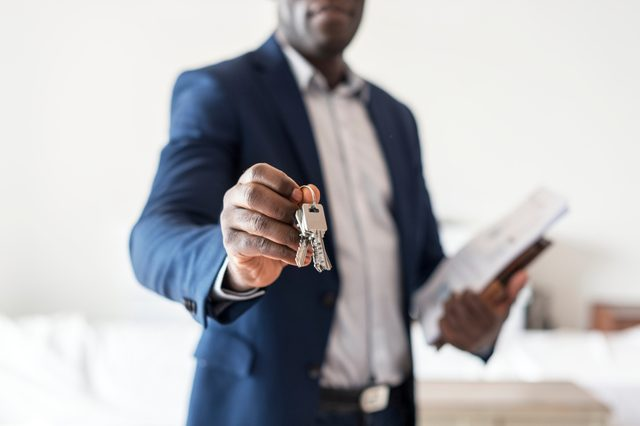 Real estate agent handing the house key