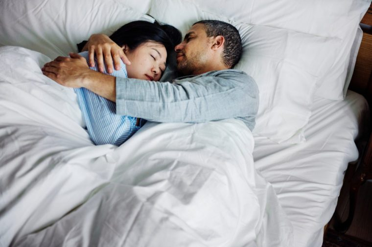 Couple hugging on a bed