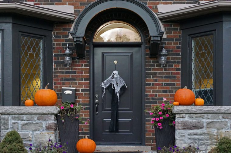 front door of house with Halloween decorations