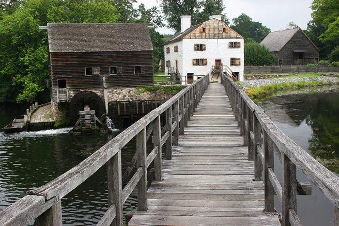 wooden bridge to historic eighteen century watermill, farm and office