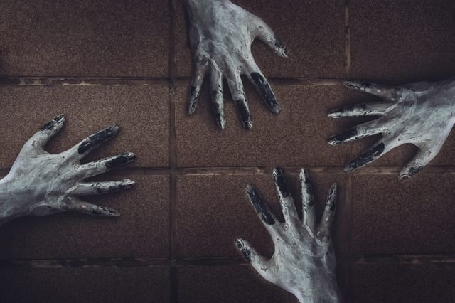 Ghost hand on the wall horror scene of woman death movie halloween festival in the dark house nightmare screaming on hell is monster devil girl or female dead characters at night evil.