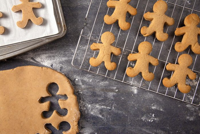 Gingerbread Cookie Dough Being Cut into People Shapes