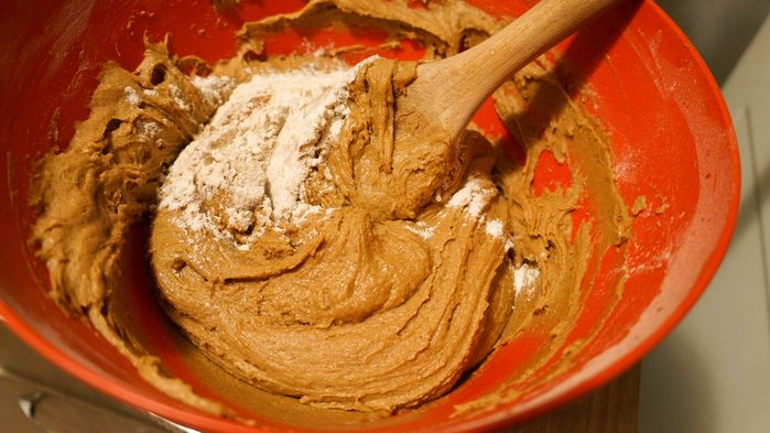 Flour with spices for gingerbread in a bowl with wood spoon