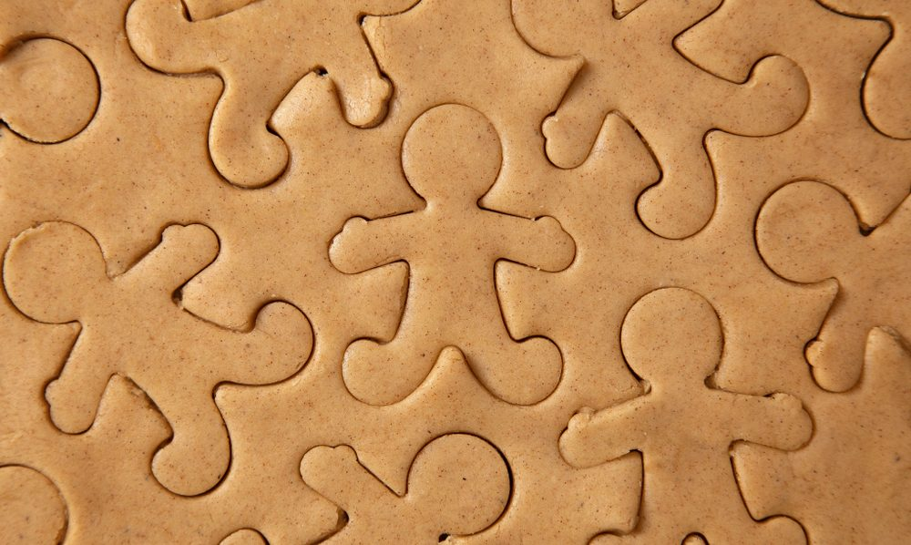 Raw Gingerbread Cookie Dough Being Cut into Gingerbread Men