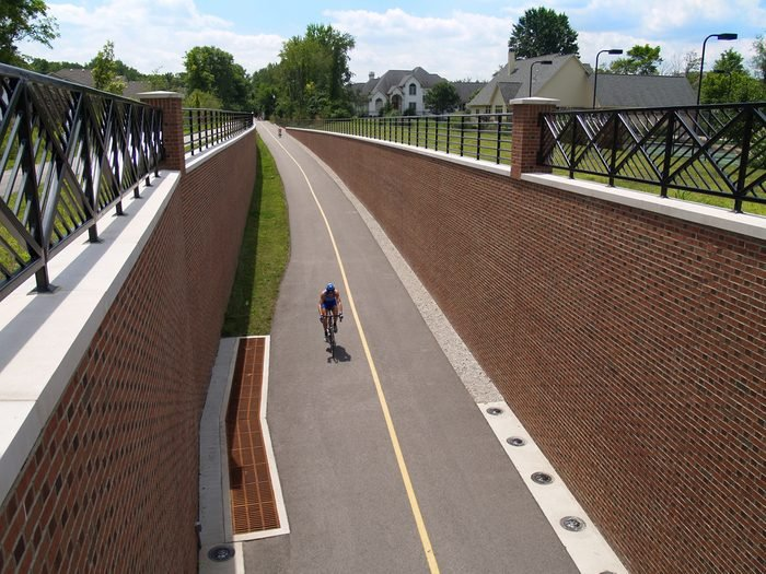 Man riding his bike on the Monon Greenway Trail in Carmel, Indiana.