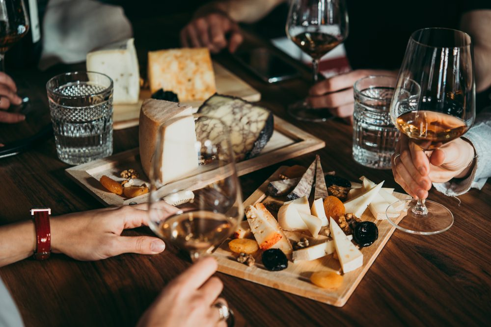 Wine and cheese served for a friendly party in a bar or a restaurant.