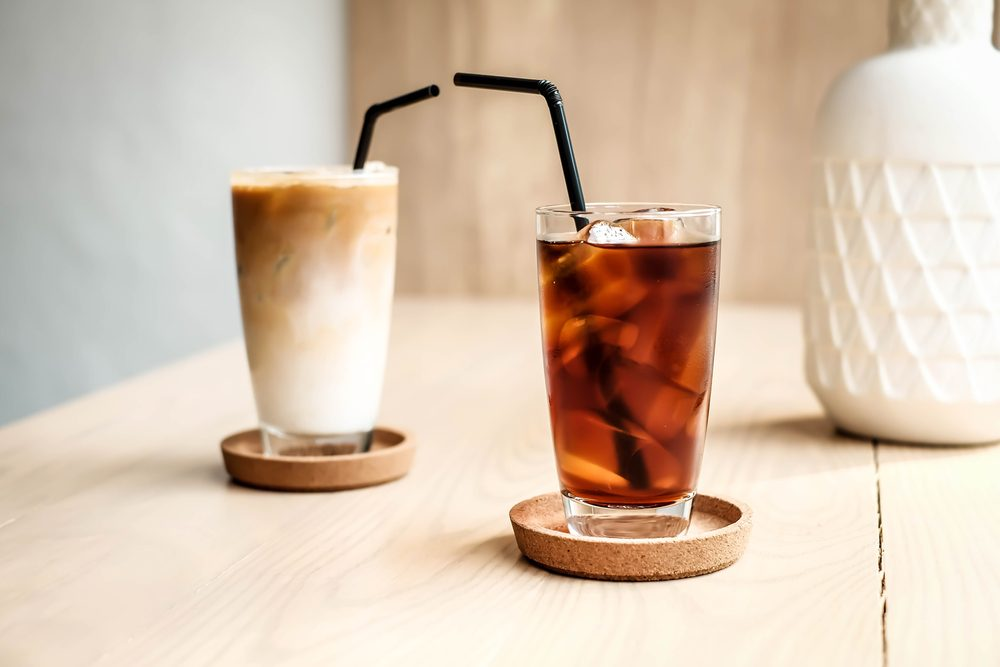 Glass of cold brew coffee and latte at cafe