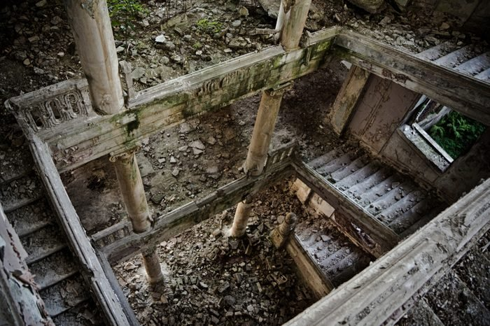 Ruined staircase with columns at abandoned mansion, Abkhazia, Georgia.
