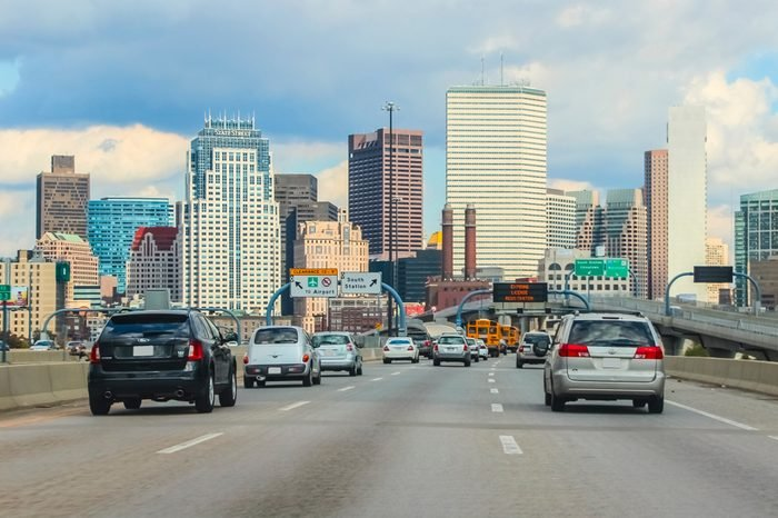 Boston, Massachusetts, USA - November 14, 2011; Boston traffic with cars driving to downtown with buildings in background during daytime